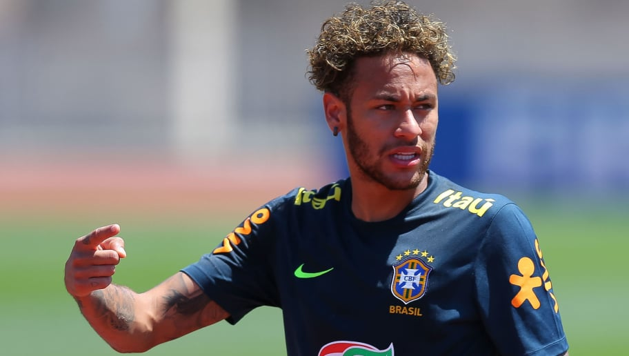 SOCHI, RUSSIA - JUNE 12:  Neymar Jr of Brazil looks on during a Brazil training session ahead of the FIFA World Cup 2018 at Yug-Sport Stadium on June 12, 2018 in Sochi, Russia.  (Photo by Buda Mendes/Getty Images)
