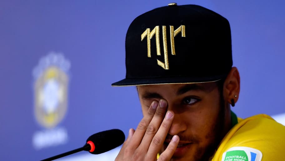 TERESOPOLIS, BRAZIL - JULY 10:  Neymar attends and speaks during a press conference on July 10, 2014 in Teresopolis, Brazil. Neymar apparently broke down in tears as he explained to the media that he was relieved the recent accident which reportedly broke a vertebrae in his back did not leave him paralysed. (Photo by Buda Mendes/Getty Images)