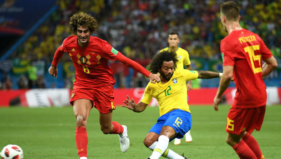 KAZAN, RUSSIA - JULY 06:  Marouane Fellaini and Thomas Meunier of Belgium put pressure on Marcelo of Brazil during the 2018 FIFA World Cup Russia Quarter Final match between Brazil and Belgium at Kazan Arena on July 6, 2018 in Kazan, Russia.  (Photo by Shaun Botterill/Getty Images)
