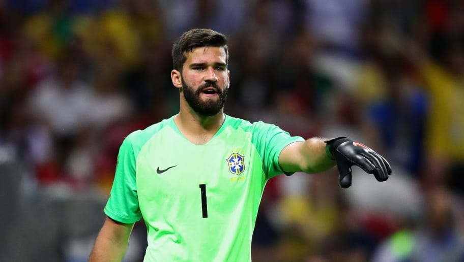 KAZAN, RUSSIA - JULY 06:  Alisson of Brazil gestures during the 2018 FIFA World Cup Russia Quarter Final match between Brazil and Belgium at Kazan Arena on July 6, 2018 in Kazan, Russia.  (Photo by Chris Brunskill/Fantasista/Getty Images)