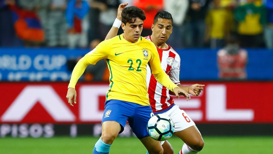 SAO PAULO, BRAZIL - MARCH 28: Fagner (L) of Brazil struggles for the ball with  Cecilio Dominguez of Paraguay during a match between Brazil and Paraguay as part of 2018 FIFA World Cup Russia Qualifier at Arena Corinthians on March 28, 2017 in Sao Paulo, Brazil. (Photo by Buda Mendes/Getty Images)
