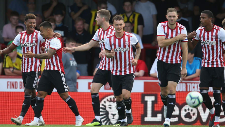 BRENTFORD, ENGLAND - JULY 28: Ollie Watkins of Brentford (L) celebrates scoring a goal with his team mates during the pre-season match between Brentford and Watford at Griffin Park on July 28, 2018 in Brentford, England. (Photo by Steve Bardens/Getty Images)
