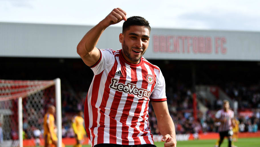 BRENTFORD, ENGLAND - SEPTEMBER 15: Neal Maupay of Brentford celebrates scoring the 2nd brentford goal during the Sky Bet Championship match between Brentford and Wigan on September 15, 2018 in Brentford, England. (Photo by Justin Setterfield/Getty Images)