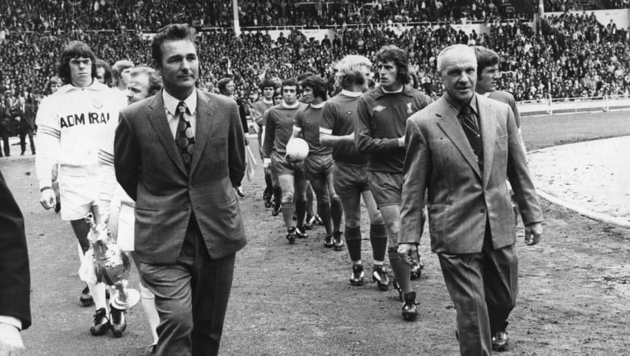 Football Club managers Brian Clough and Bill Shankly (1913 - 1981) lead out their teams at Wembley Stadium for the Charity Shield match between league champions Leeds United and FA Cup winners Liverpool.  Original Publication: People Disc - HO0268   (Photo by Evening Standard/Getty Images)