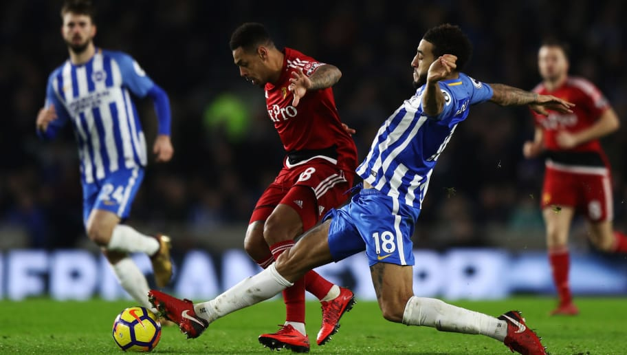 BRIGHTON, ENGLAND - DECEMBER 23:  Connor Goldson of Brighton and Hove Albion tackles Andre Gray of Watford during the Premier League match between Brighton and Hove Albion and Watford at Amex Stadium on December 23, 2017 in Brighton, England.  (Photo by Bryn Lennon/Getty Images)