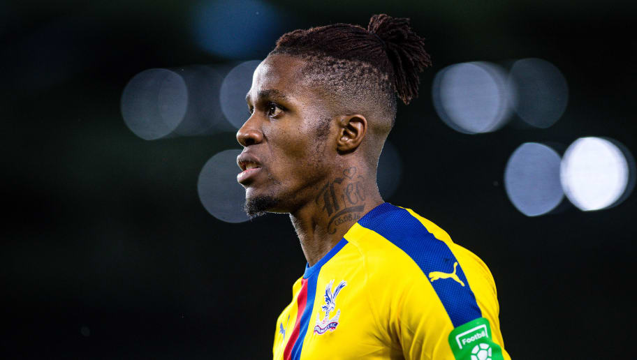 BRIGHTON, ENGLAND - DECEMBER 04: Wilfried Zaha of Crystal Palace looks on during the Premier League match between Brighton & Hove Albion and Crystal Palace at American Express Community Stadium on December 4, 2018 in Brighton, United Kingdom. (Photo by Sebastian Frej/MB Media/Getty Images)