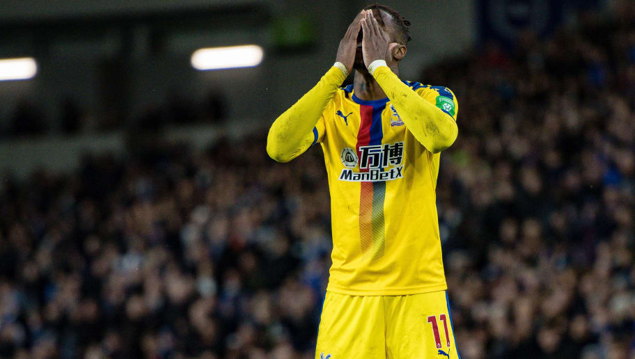 BRIGHTON, ENGLAND - DECEMBER 04: Wilfried Zaha of Crystal Palace reaction during the Premier League match between Brighton & Hove Albion and Crystal Palace at American Express Community Stadium on December 4, 2018 in Brighton, United Kingdom. (Photo by Sebastian Frej/MB Media/Getty Images)