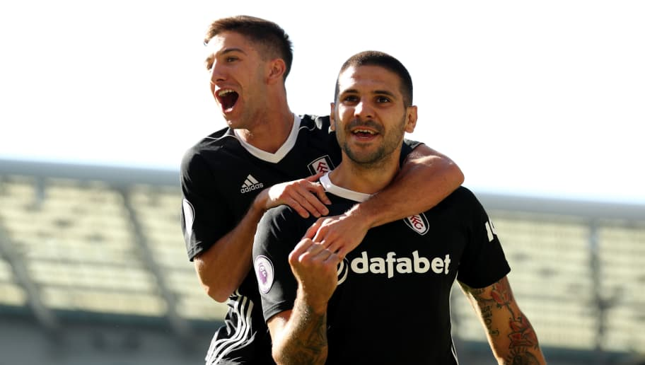BRIGHTON, ENGLAND - SEPTEMBER 01:  Aleksandar Mitrovic of Fulham celebrates with teammate Luciano Vietto after scoring his team's second goal during the Premier League match between Brighton & Hove Albion and Fulham FC at American Express Community Stadium on September 1, 2018 in Brighton, United Kingdom.  (Photo by Bryn Lennon/Getty Images)