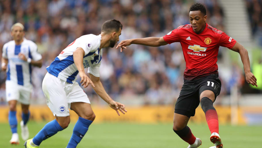 BRIGHTON, ENGLAND - AUGUST 19:  Martin Montoya of Brighton and Hove Albion and Anthony Martial of Manchester United battle for the ball during the Premier League match between Brighton & Hove Albion and Manchester United at American Express Community Stadium on August 19, 2018 in Brighton, United Kingdom.  (Photo by Dan Istitene/Getty Images)