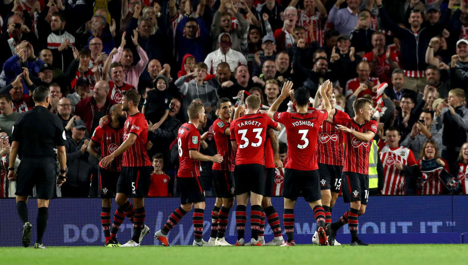 BRIGHTON, ENGLAND - AUGUST 28:  Charlie Austin of Southampton celebrates with teammates after scoring his team's first goal during the Carabao Cup Second Round match between Brighton & Hove Albion and Southampton at American Express Community Stadium on August 28, 2018 in Brighton, England.  (Photo by Bryn Lennon/Getty Images)