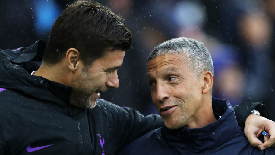 BRIGHTON, ENGLAND - SEPTEMBER 22:  Mauricio Pochettino, Manager of Tottenham Hotspur and Chris Hughton, Manager of Brighton and Hove Albion embrace prior to the Premier League match between Brighton & Hove Albion and Tottenham Hotspur at American Express Community Stadium on September 22, 2018 in Brighton, United Kingdom.  (Photo by Dan Istitene/Getty Images)