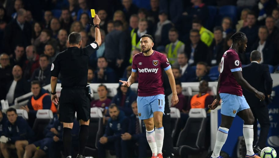 BRIGHTON, ENGLAND - OCTOBER 05:  Robert Snodgrass of West Ham United is shown a yellow card by referee Kevin Friend during the Premier League match between Brighton & Hove Albion and West Ham United at American Express Community Stadium on October 5, 2018 in Brighton, United Kingdom.  (Photo by Mike Hewitt/Getty Images)