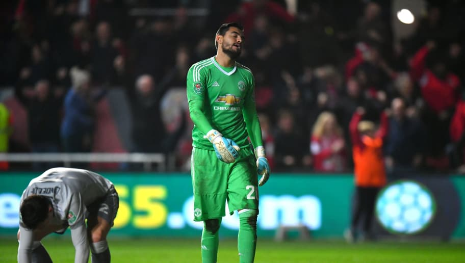 BRISTOL, ENGLAND - DECEMBER 20:  Victor Lindelof of Manchester United and teammate Sergio Romero look dejected after conceding during the Carabao Cup Quarter-Final match between Bristol City and Manchester United at Ashton Gate on December 20, 2017 in Bristol, England.  (Photo by Dan Mullan/Getty Images)