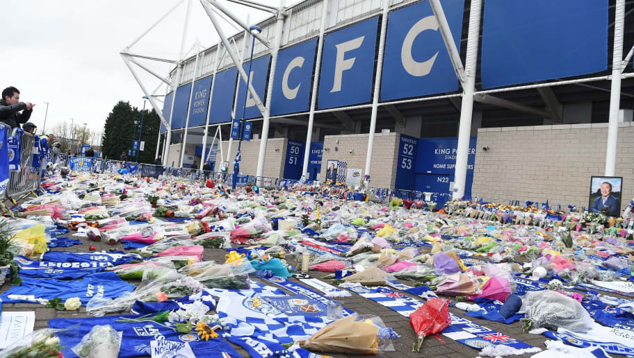 A man pauses at the floral tributes outside Leicester City Football Club's King Power Stadium in Leicester, eastern England, on October 30, 2018 left after five passengers were killed in a helicopter crash at the stadium including the club's Thai chairman Vichai Srivaddhanaprabha. - Leicester City's chairman Vichai Srivaddhanaprabha was among five people killed when his helicopter crashed and burst into flames in the Premier League side's stadium car park moments after taking off from the pitch, the club said on October 28. The family of the late Thai billionaire boss of Premier League club Leicester City laid a wreath on October 29 at the site where his helicopter crashed as investigators began examining the aircraft's black box. (Photo by Paul ELLIS / AFP)        (Photo credit should read PAUL ELLIS/AFP/Getty Images)