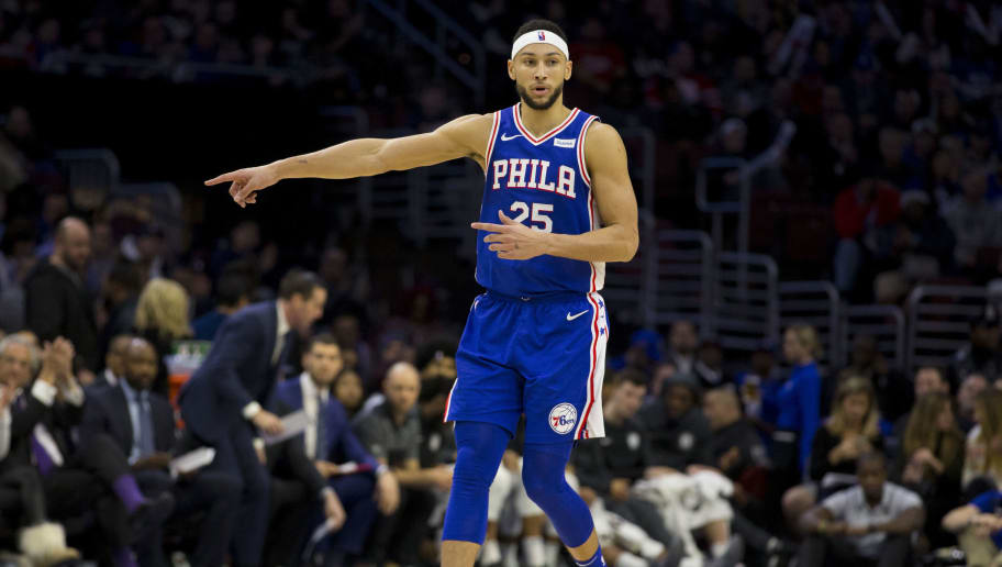 PHILADELPHIA, PA - DECEMBER 12: Ben Simmons #25 of the Philadelphia 76ers points against the Brooklyn Nets at the Wells Fargo Center on December 12, 2018 in Philadelphia, Pennsylvania. NOTE TO USER: User expressly acknowledges and agrees that, by downloading and or using this photograph, User is consenting to the terms and conditions of the Getty Images License Agreement. (Photo by Mitchell Leff/Getty Images)