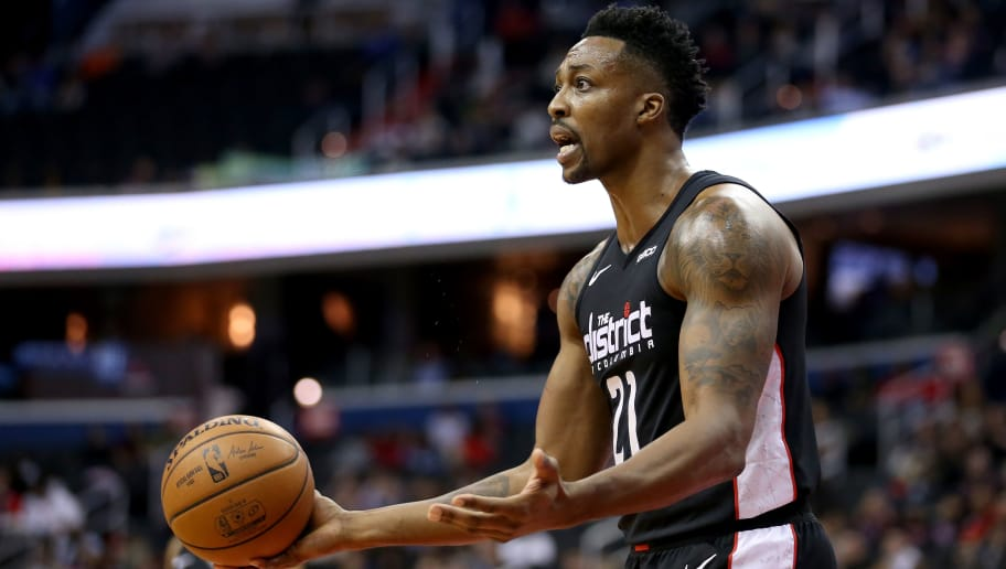 WASHINGTON, DC - NOVEMBER 16: Dwight Howard #21 of the Washington Wizards reacts after a play during the second half against the Brooklyn Nets at Capital One Arena on November 16, 2018 in Washington, DC. NOTE TO USER: User expressly acknowledges and agrees that, by downloading and or using this photograph, User is consenting to the terms and conditions of the Getty Images License Agreement. (Photo by Will Newton/Getty Images)