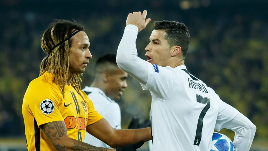 BERN, SWITZERLAND - DECEMBER 12: Kevin Mbabu of Young Boys, Cristiano Ronaldo of Juventus during the UEFA Champions League Group H match between BSC Young Boys and Juventus at Stade de Suisse, Wankdorf on December 12, 2018 in Bern, Switzerland. (Photo by TF-Images/TF-Images via Getty Images)