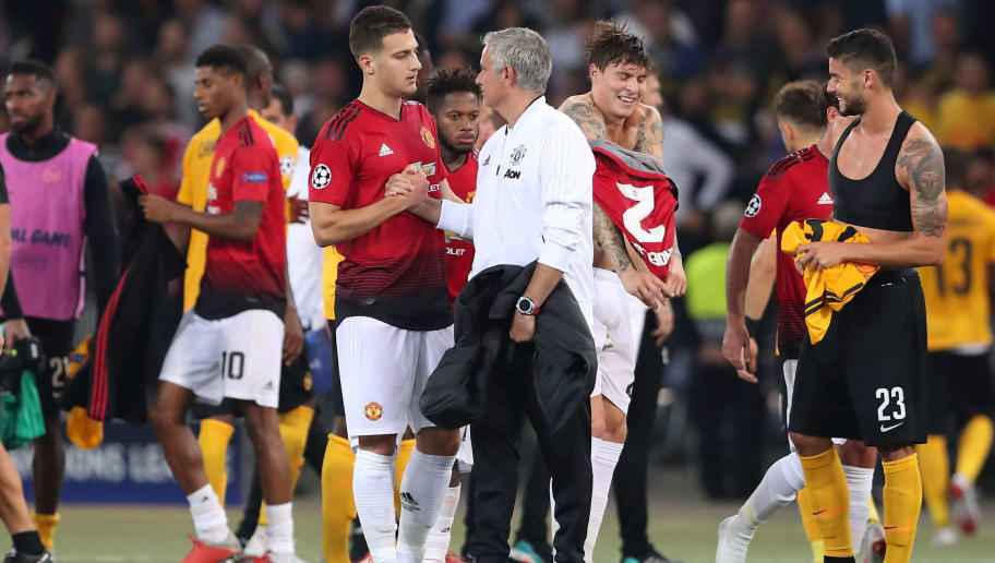 BERN, SWITZERLAND - SEPTEMBER 19: Diogo Dalot of Manchester United and Manchester United Manager \ Head Coach Jose Mourinho during the Group H match of the UEFA Champions League between BSC Young Boys and Manchester United at Stade de Suisse, Wankdorf on September 19, 2018 in Bern, Switzerland. (Photo by James Williamson - AMA/Getty Images)