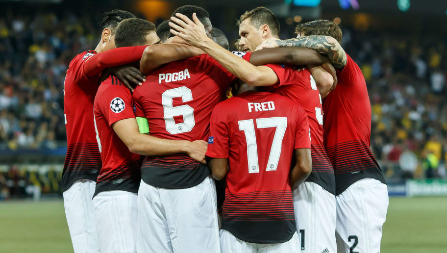 BERN, SWITZERLAND - SEPTEMBER 19:  Paul Pogba of Manchester United celebrates after scoring his team`s first goal with team mates during the UEFA Champions League Group H match between BSC Young Boys and Manchester United at Stade de Suisse, Wankdorf on September 19, 2018 in Bern, Switzerland. (Photo by TF-Images/Getty Images)
