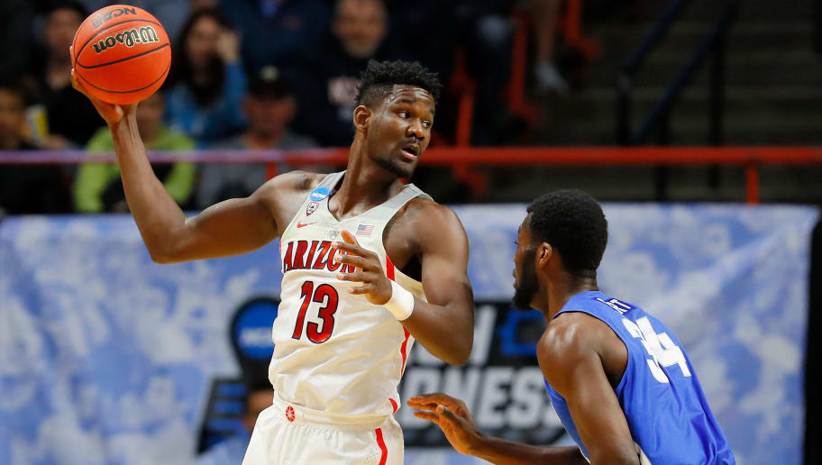 BOISE, ID - MARCH 15:  Deandre Ayton #13 of the Arizona Wildcats handles the ball in the first half against Ikenna Smart #34 of the Buffalo Bulls during the first round of the 2018 NCAA Men's Basketball Tournament at Taco Bell Arena on March 15, 2018 in Boise, Idaho.  (Photo by Kevin C. Cox/Getty Images)