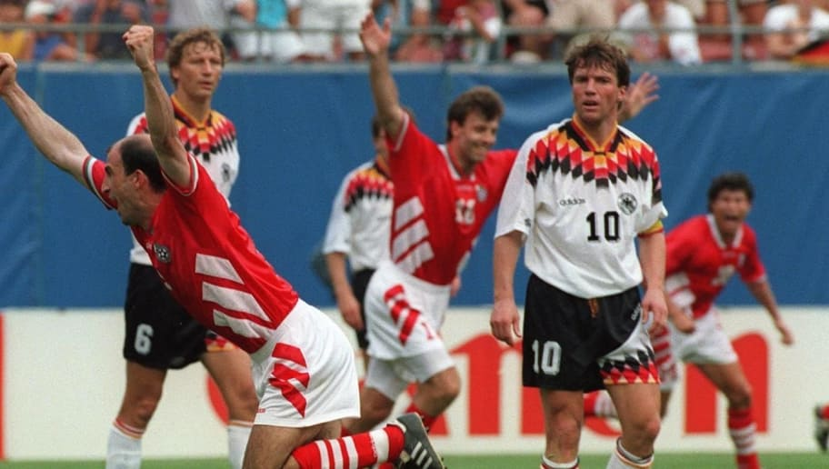 EAST RUTHERFORD, UNITED STATES:  Bulgarian forward Iordan Letchkov celebrates after scoring the winning goal during the World Cup quarterfinal soccer match between Bulgaria and West Germany 10 July 1994 in East Rutherford. Bulgaria beat West Germany 3-2 to advance to the semifinals. (Standing around, from left, are West Germans Guido Buchwald, Lothar Matthaeus and Thomas Haessler)   AFP PHOTO/JEAN-LOUP GAUTREAU (Photo credit should read JEAN-LOUP GAUTREAU/AFP/Getty Images)