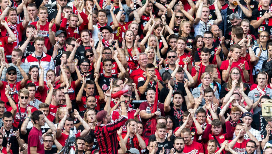 (L-R) suupporters of Bayer 04 Leverkusen DFL REGULATIONS PROHIBIT ANY USE OF PHOTOGRAPHS AS IMAGE SEQUENCES AND/OR QUASI-VIDEO during the Bundesliga match between Bayer 04 Leverkusen and VFL Wolfsburg at the BayArena,  on September 01, 2018 in Leverkusen, Germany(Photo by VI Images via Getty Images)