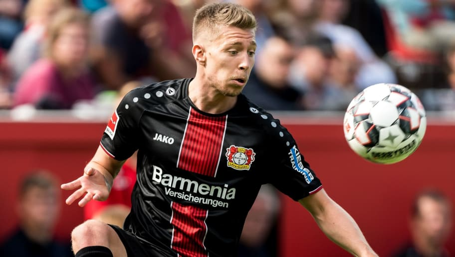 (L-R) Mitchell Weiser of Bayer 04 Leverkusen DFL REGULATIONS PROHIBIT ANY USE OF PHOTOGRAPHS AS IMAGE SEQUENCES AND/OR QUASI-VIDEO during the Bundesliga match between Bayer 04 Leverkusen and VFL Wolfsburg at the BayArena,  on September 01, 2018 in Leverkusen, Germany(Photo by VI Images via Getty Images)