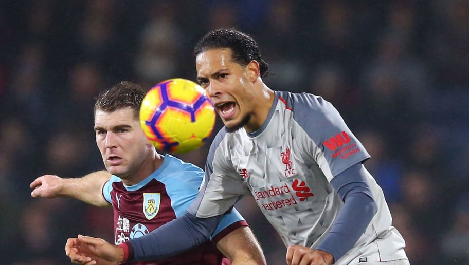 BURNLEY, ENGLAND - DECEMBER 05:  Virgil van Dijk of Liverpool battles for possession with Sam Vokes of Burnley during the Premier League match between Burnley FC and Liverpool FC at Turf Moor on December 5, 2018 in Burnley, United Kingdom.  (Photo by Alex Livesey/Getty Images)