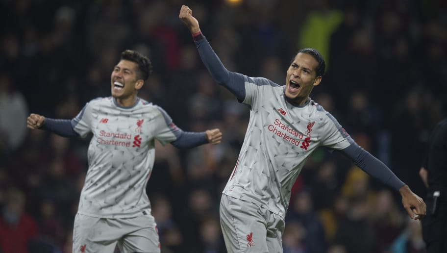 BURNLEY, ENGLAND - DECEMBER 05: Virgil van Dijk and Roberto Firmino of Liverpool celebate combining for their second goal during the Premier League match between Burnley FC and Liverpool FC at Turf Moor on December 5, 2018 in Burnley, United Kingdom. (Photo by Visionhaus/Getty Images)