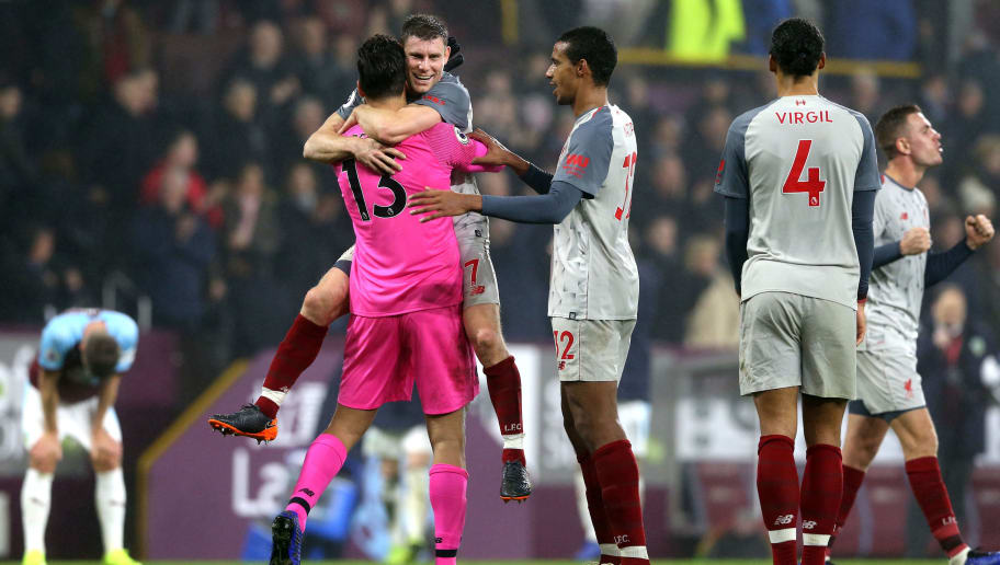 BURNLEY, ENGLAND - DECEMBER 05:  Alisson of Liverpool, James Milner of Liverpool and Joel Matip of Liverpool celebrate following their sides victory in the Premier League match between Burnley FC and Liverpool FC at Turf Moor on December 5, 2018 in Burnley, United Kingdom.  (Photo by Nigel Roddis/Getty Images)