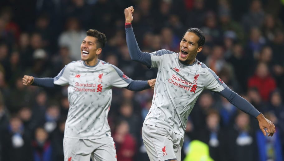 BURNLEY, ENGLAND - DECEMBER 05:  Roberto Firmino of Liverpool celebrates with team mate Virgil van Dijk of Liverpool after scoring their team's second goal during the Premier League match between Burnley FC and Liverpool FC at Turf Moor on December 5, 2018 in Burnley, United Kingdom.  (Photo by Alex Livesey/Getty Images)