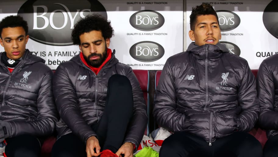 BURNLEY, ENGLAND - DECEMBER 05:  Trent Alexander-Arnold of Liverpool, Mohamed Salah of Liverpool and Roberto Firmino of Liverpool looks on from the bench during the Premier League match between Burnley FC and Liverpool FC at Turf Moor on December 5, 2018 in Burnley, United Kingdom.  (Photo by Alex Livesey/Getty Images)