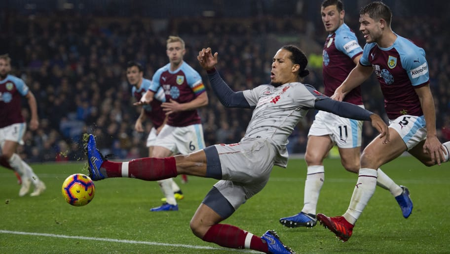 BURNLEY, ENGLAND - DECEMBER 05: Virgil van Dijk of Liverpool knocks the ball across the goal for Roberto Firmino to score during the Premier League match between Burnley FC and Liverpool FC at Turf Moor on December 5, 2018 in Burnley, United Kingdom. (Photo by Visionhaus/Getty Images)