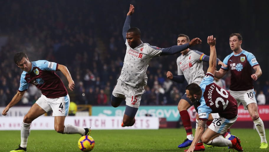 BURNLEY, ENGLAND - DECEMBER 05:  Daniel Sturridge of Liverpool is tackled by Phillip Bardsley of Burnley during the Premier League match between Burnley FC and Liverpool FC at Turf Moor on December 5, 2018 in Burnley, United Kingdom.  (Photo by Nigel Roddis/Getty Images)