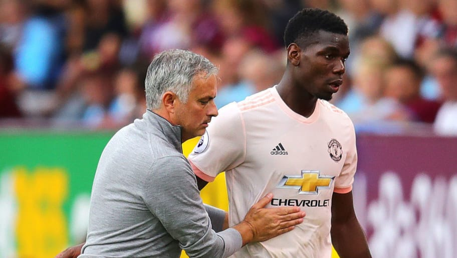 BURNLEY, ENGLAND - SEPTEMBER 02: Manchester United manager Jose Mourinho embraces Paul Pogba as he leaves the field after being substituted during the Premier League match between Burnley FC and Manchester United at Turf Moor on September 2, 2018 in Burnley, United Kingdom. (Photo by Chris Brunskill/Fantasista/Getty Images)