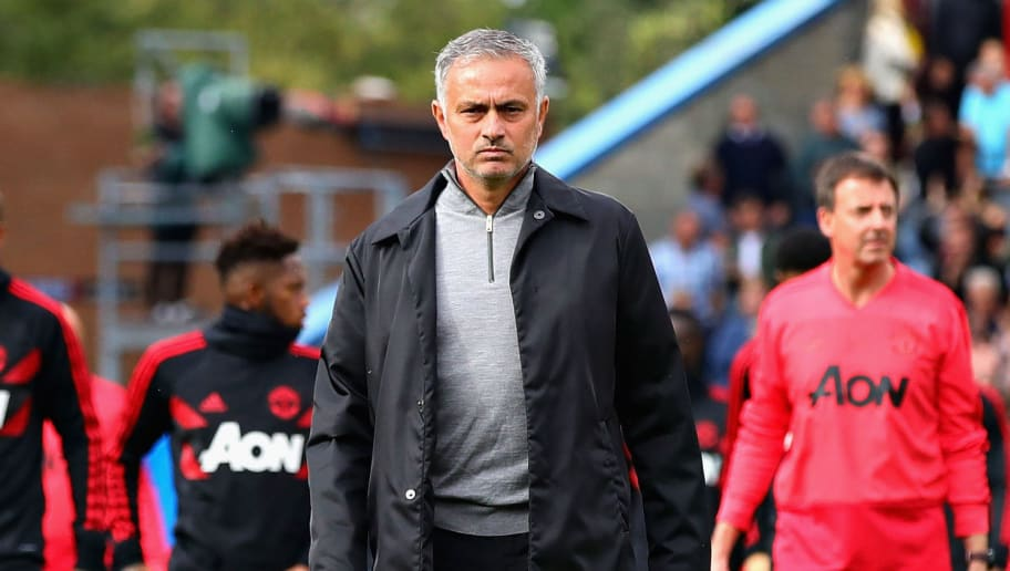 BURNLEY, ENGLAND - SEPTEMBER 02: Manager of Manchester United Jose Mourinho and his team walk on the pitch before the Premier League match between Burnley FC and Manchester United at Turf Moor on September 2, 2018 in Burnley, United Kingdom.  (Photo by Chris Brunskill/Fantasista/Getty Images)