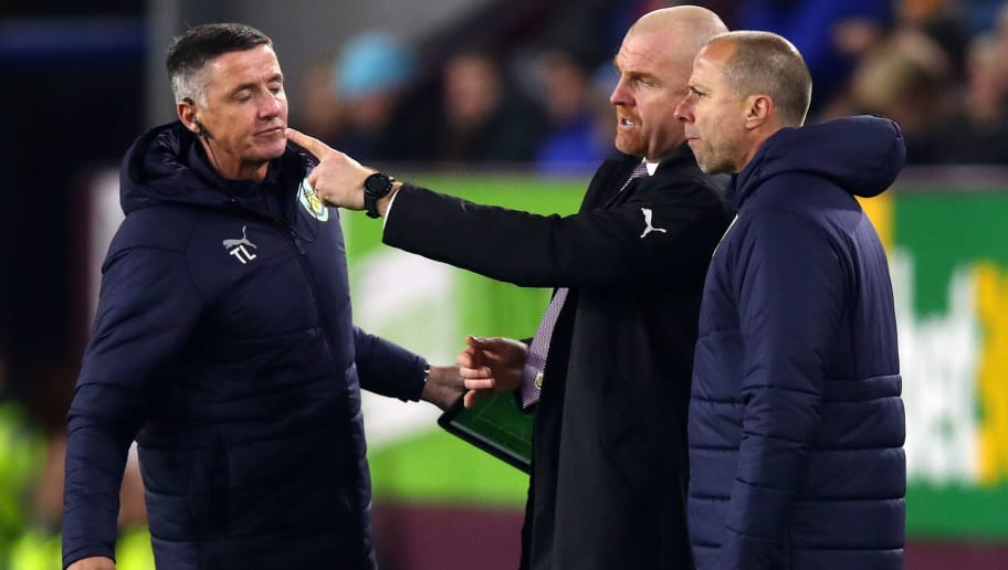 BURNLEY, ENGLAND - NOVEMBER 26:  Sean Dyche, Manager of Burnley (C) in discussion with assistant Ian Woan (R) and coach Tony Loughlan (L) during the Premier League match between Burnley FC and Newcastle United at Turf Moor on November 26, 2018 in Burnley, United Kingdom.  (Photo by Clive Brunskill/Getty Images)