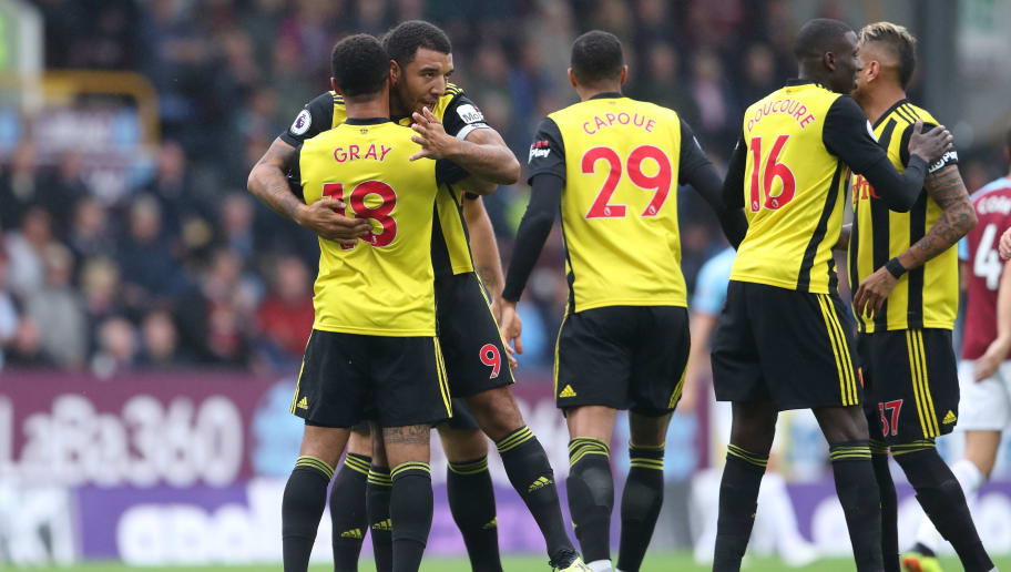 BURNLEY, ENGLAND - AUGUST 19: Andre Gray of Watford celebrates after scoring a goal to make it 1-0 with Troy Deeney of Watford during the Premier League match between Burnley FC and Watford FC at Turf Moor on August 19, 2018 in Burnley, United Kingdom. (Photo by James Williamson - AMA/Getty Images)
