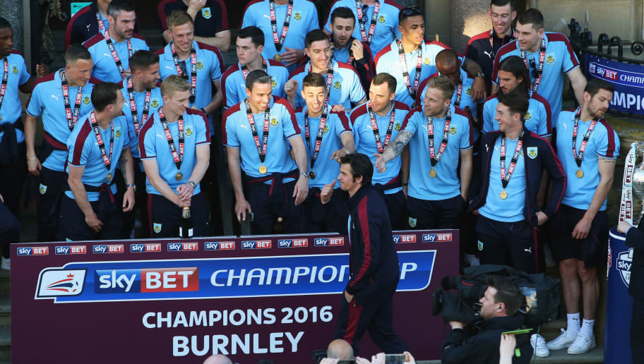 BURNLEY, ENGLAND - MAY 09:  Joey Barton (front) reacts in front of team mates as he is not presented with a medal as Sky Bet Champions Burnley are presented with the Championship trophy at the Town Hall on May 9, 2016 in Burnley, England.  (Photo by Jan Kruger/Getty Images)
