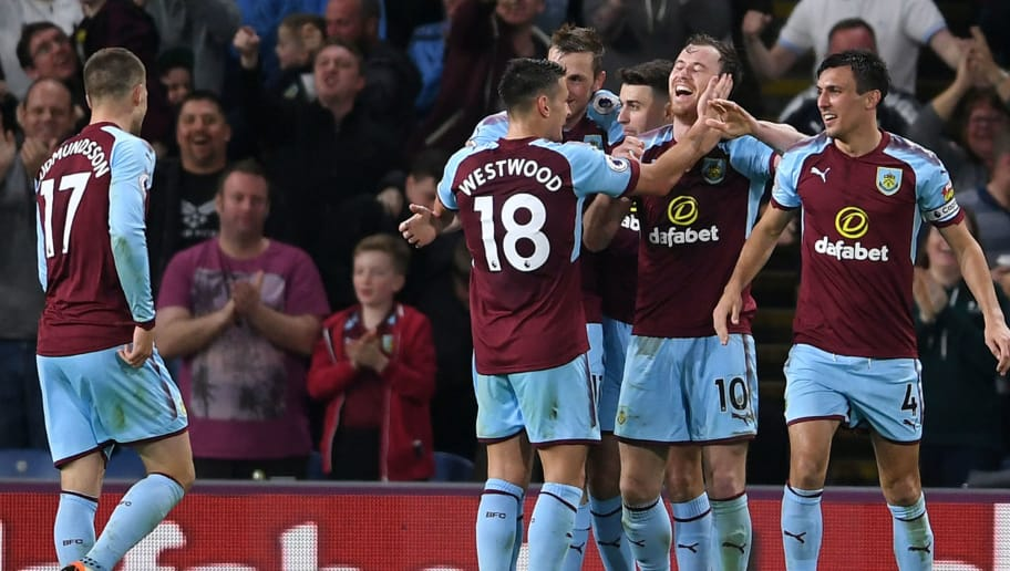 BURNLEY, ENGLAND - APRIL 19:  Ashley Barnes of Burnley celebrates with teammates after scoring his sides first goal during the Premier League match between Burnley and Chelsea at Turf Moor on April 19, 2018 in Burnley, England.  (Photo by Laurence Griffiths/Getty Images)