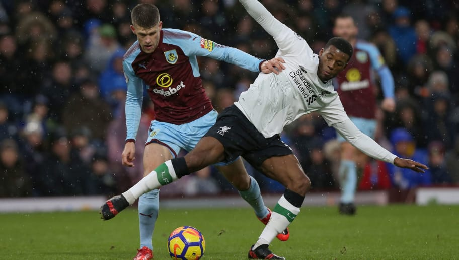 BURNLEY, ENGLAND - JANUARY 01:  Georginio Wijnaldum of Liverpool is challenged by Johann Gudmundsson of Burnley during the Premier League match between Burnley and Liverpool at Turf Moor on January 1, 2018 in Burnley, England.  (Photo by Nigel Roddis/Getty Images)