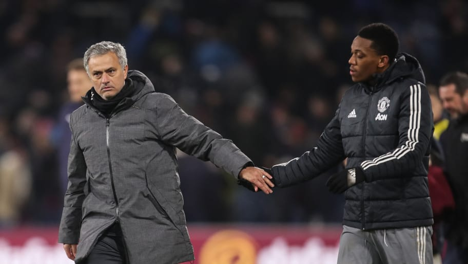 BURNLEY, ENGLAND - JANUARY 20: Jose Mourinho the head coach / manager of Manchester United and Anthony Martial of Manchester United celebrate at full time during the Premier League match between Burnley and Manchester United at Turf Moor on January 20, 2018 in Burnley, England. (Photo by Robbie Jay Barratt - AMA/Getty Images)
