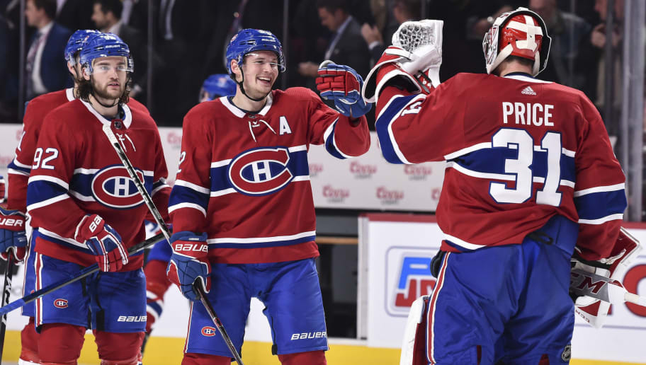 MONTREAL, QC - OCTOBER 23:  Artturi Lehkonen #62 of the Montreal Canadiens congratulates goaltender Carey Price #31 on a win against the Calgary Flames  at the Bell Centre on October 23, 2018 in Montreal, Quebec, Canada.  The Montreal Canadiens defeated the Calgary Flames 3-2.  (Photo by Minas Panagiotakis/Getty Images)