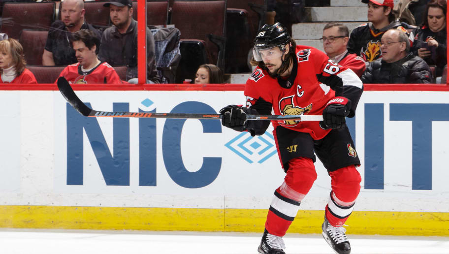 OTTAWA, ON - MARCH 9:  Erik Karlsson #65 of the Ottawa Senators passes the puck against the Calgary Flames at Canadian Tire Centre on March 9, 2018 in Ottawa, Ontario, Canada.  (Photo by Jana Chytilova/Freestyle Photography/Getty Images) *** Local Caption ***