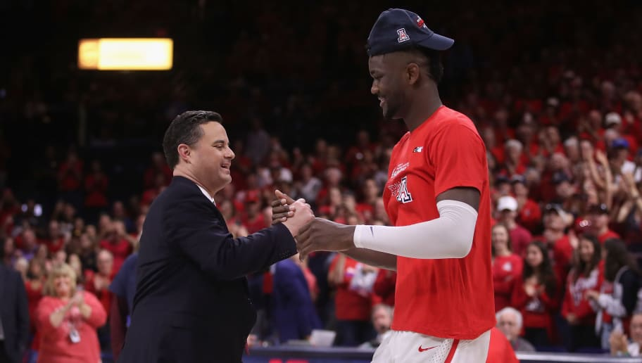 TUCSON, AZ - MARCH 03:  Head coach Sean Miller of the Arizona Wildcats greets Deandre Ayton #13 after defeating the California Golden Bears 66-54 to win the PAC-12 Championship at McKale Center on March 3, 2018 in Tucson, Arizona.  (Photo by Christian Petersen/Getty Images)