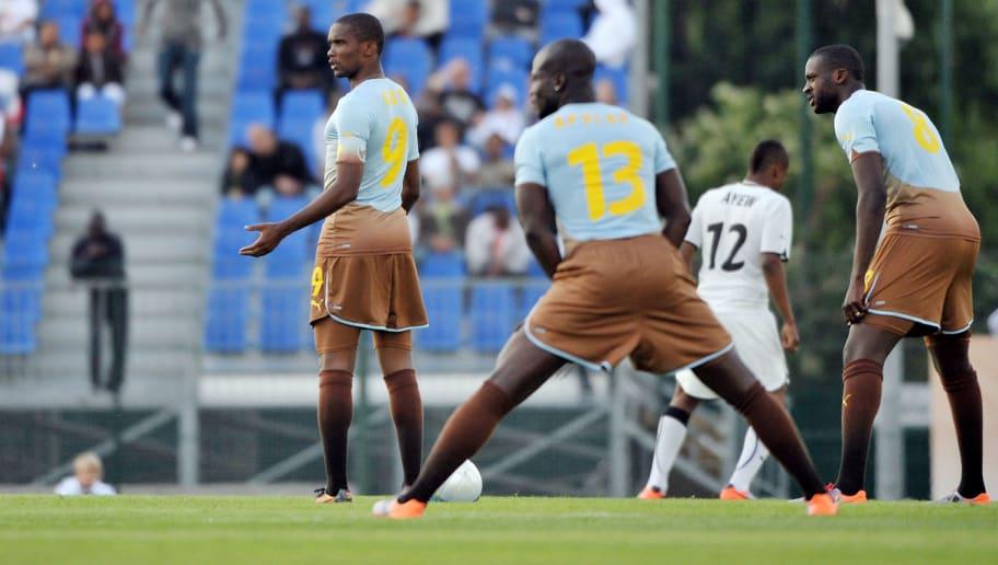 Cameroonian captain Samuel Eto'o (L) tak