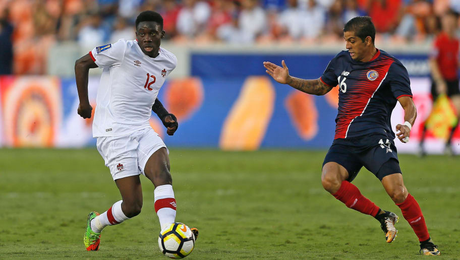 HOUSTON, TX - JULY 11:  Alphonso Davies #12 of Canada dribbles the ball  past Christian Gamboa #16 of Costa Rica at BBVA Compass Stadium on July 11, 2017 in Houston, Texas.  (Photo by Bob Levey/Getty Images)
