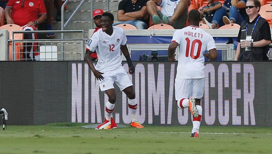 HOUSTON, TX - JULY 11:  Alphonso Davies #12 of Canada celebrates with this teammates after scoring against Canada in the first half at BBVA Compass Stadium on July 11, 2017 in Houston, Texas.  (Photo by Bob Levey/Getty Images)