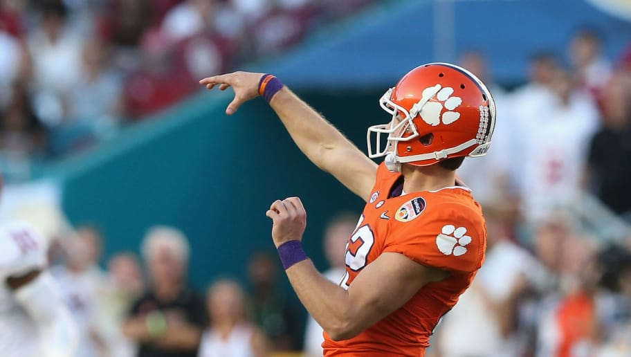MIAMI GARDENS, FL - DECEMBER 31:  Andy Teasdall #32 of the Clemson Tigers throws a pass on a fake punt attempt in the second quarter against the Oklahoma Sooners during the 2015 Capital One Orange Bowl at Sun Life Stadium on December 31, 2015 in Miami Gardens, Florida.  (Photo by Streeter Lecka/Getty Images)