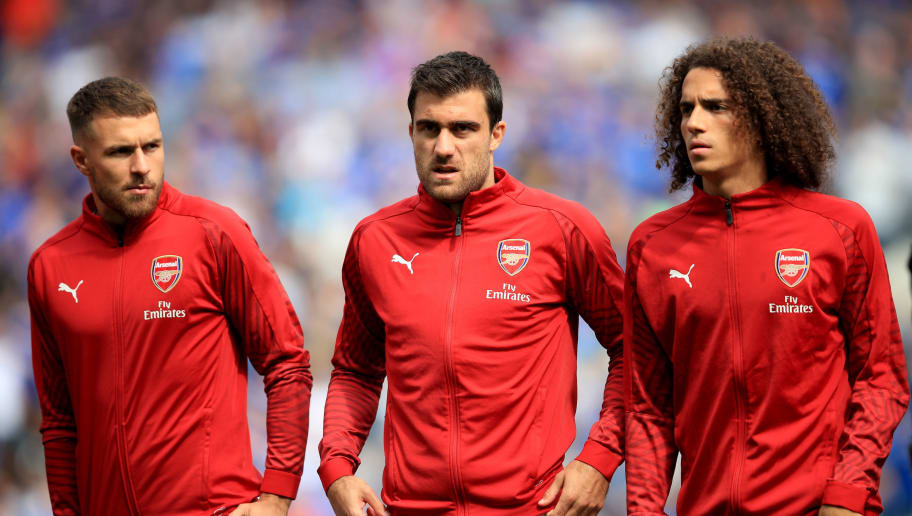 CARDIFF, WALES - SEPTEMBER 02: Aaron Ramsey, Sokratis Papastathopoulos and Matteo Guendouzi of Arsenal during the Premier League match between Cardiff City and Arsenal FC at Cardiff City Stadium on September 2, 2018 in Cardiff, United Kingdom. (Photo by Marc Atkins/Getty Images)